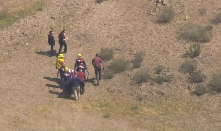 IMAGE: Parachutist removed from accident scene