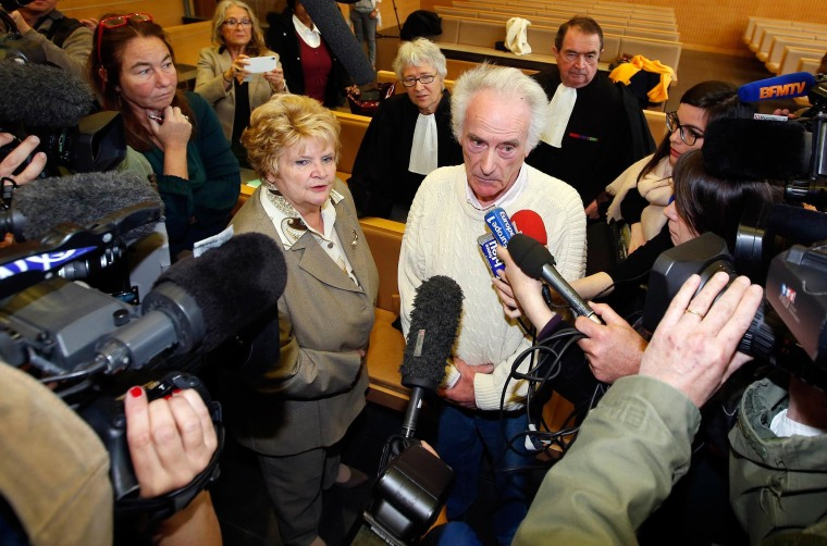 Pierre Le Guennec (R) and his wife Danielle (L) are surrounded by the media following the verdict of their trial at the courthouse in Grasse, southeastern France on Friday.