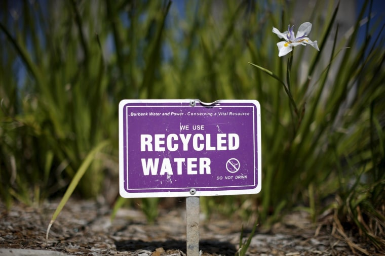 Image: A sign indicating that recycled water is used to water plants is seen in Burbank, Los Angeles