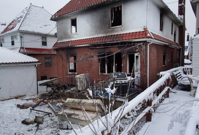 Image: Debris lay scattered behind the house at the scene of a fire
