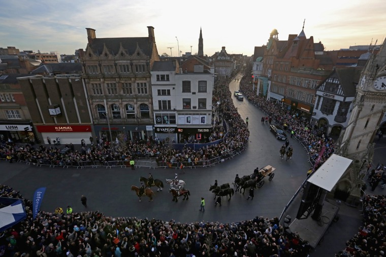 The coffin containing the remains of King Richard III is carried in a procession for interment at Leicester Cathedral on March 22, 2015 in Leicester, England.