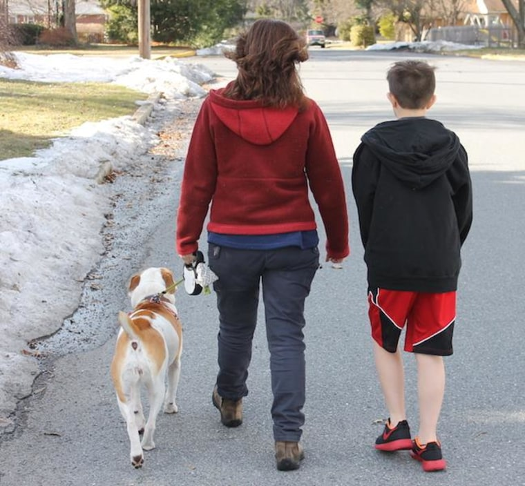 "The author walking her son to school. ""It's during the walks to and from school that my son is his most talkative. For instance, a few days ago, we spent a good half-mile debating how it is that a dog—who walks on four legs—could spin out on ice more than a human who walks on two. We still don't know the answer."""