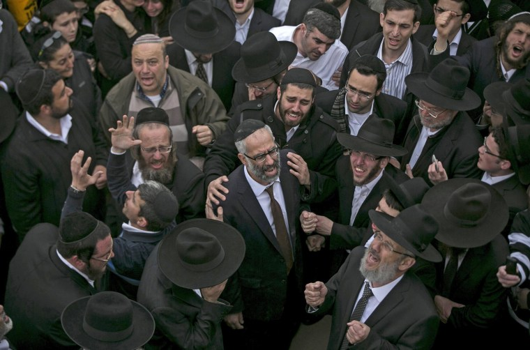 Image: Gabriel Sassoon attends the burial ceremony for his seven children in Jerusalem