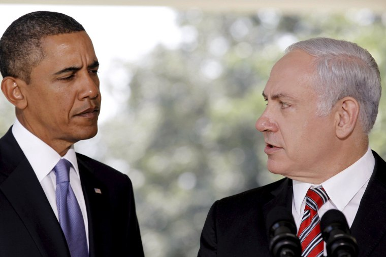 Image: File photo of U.S. President Obama listening as Israeli PM Netanyahu delivers a statement in Washington