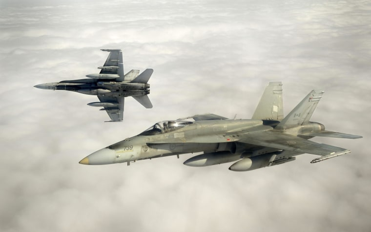 Canadian Forces CF-18 fighter jets take part in military exercises near Keflavik, Iceland on April 5, 2013.