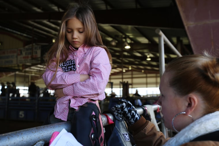 Image: Jadeyn Laura, 7, after she got stepped on during a calf-riding competition