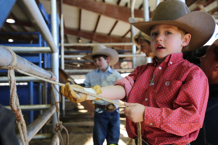 Image: W.K. Seymour, 6, a mutton-buster on the youth rodeo circuit.
