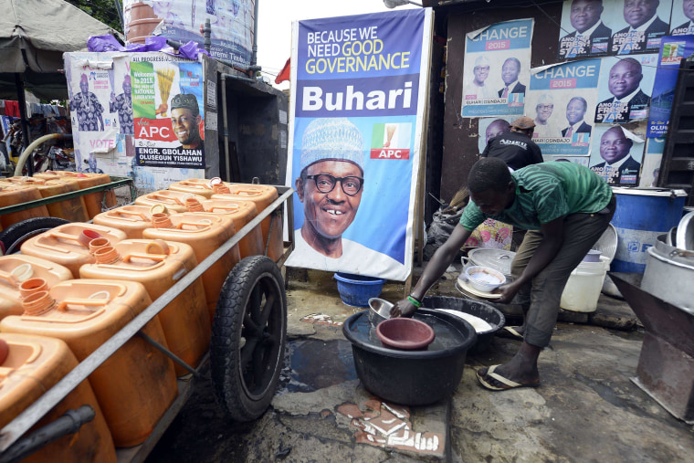 Image: A roadside restaurant features on March 12, a poster of main opposition All Progressives Congress (APC) presidential candidate Mohammadu Buhari in Lagos. Buhari, the 72-year-old candidate of the APC is in neck-and-neck with President Goodluck Jonat