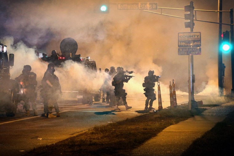 ferguson unrest missouri police agencies agree to limit use of tear