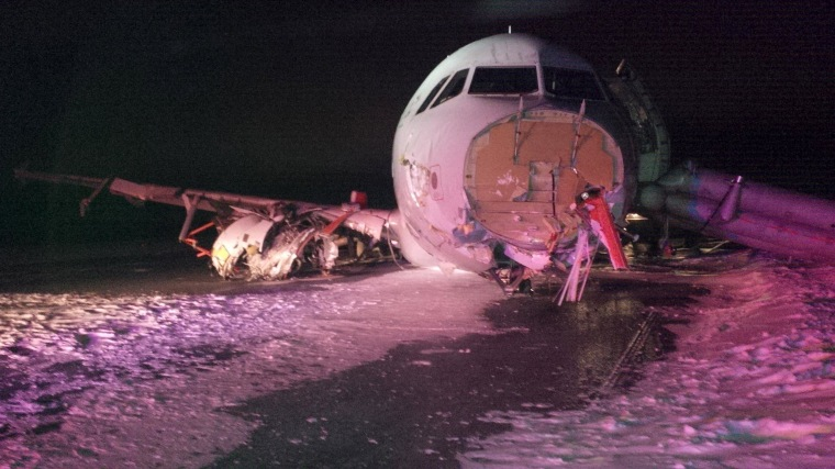 Image: Air Canada Airbus A320 lies in the snow after it skidded off the runway at Halifax International Airport