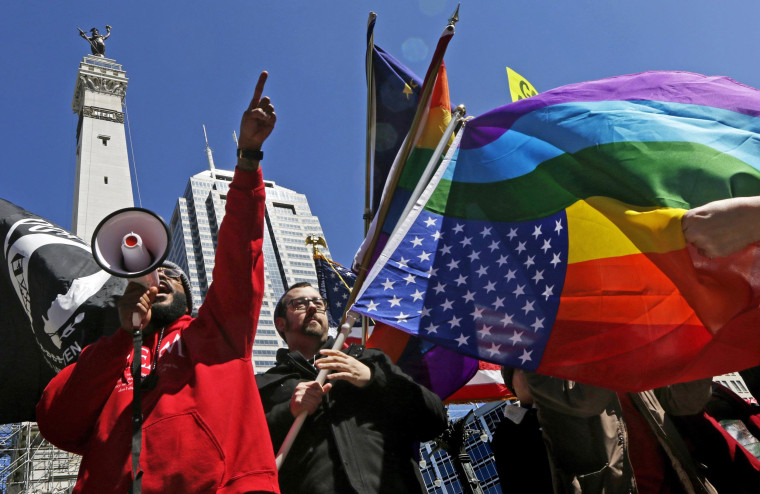 Image: Demonstrators gather to protest a controversial religious freedom bill in Indianapolis