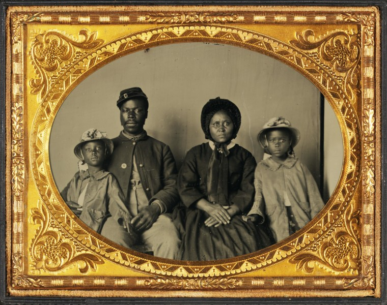 Quarter-Plate Ambrotype taken between 1863 and 1865. Image depicts a Black Union Army private and his wife and twin daughters. This image has recently become something of an icon of the African American experience during the American Civil War.