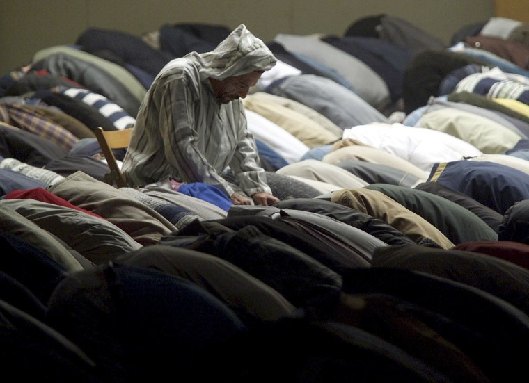 Image: File photo of Muslims praying during Friday prayers outside Milan's mosque