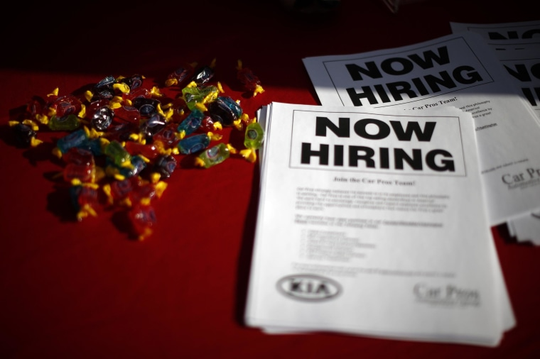 Image: File photo of leaflets lie on a table at a booth at a military veterans' job fair in Carson