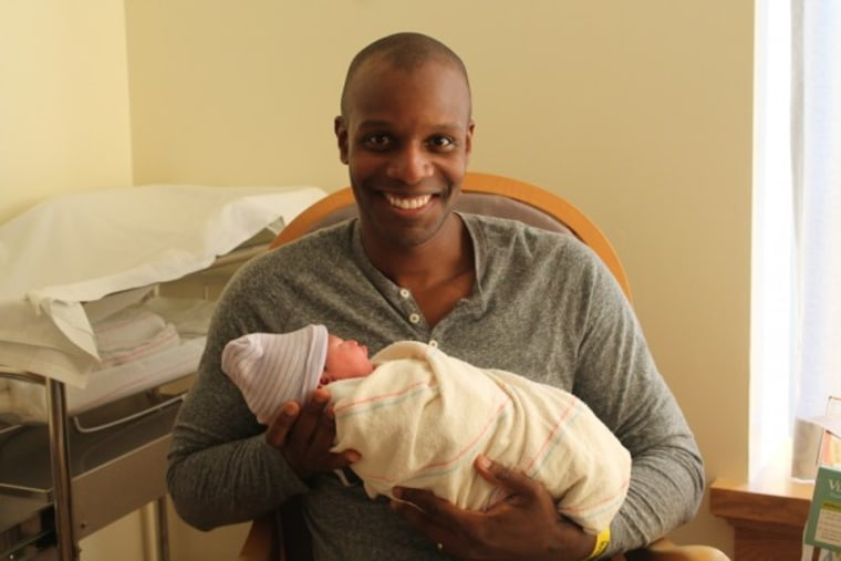 Doyin Richards and his youngest daughter on her birth day.