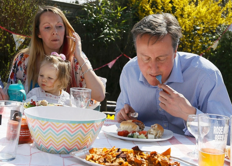 Image: Britain's Prime Minister David Cameron with Lilli Docherty and her daughter Dakota
