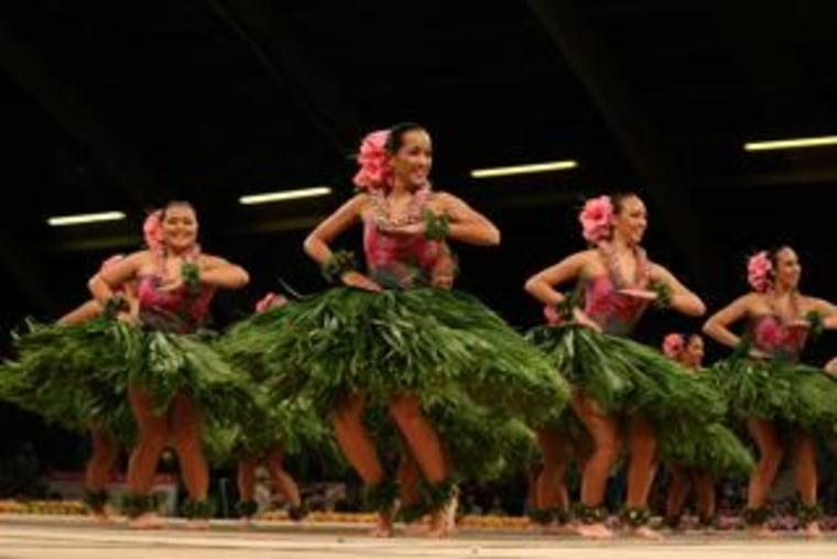 Female dancers perform at the 2014 Merrie Monarch Festival — Hula Hālau 'O Kamuela.