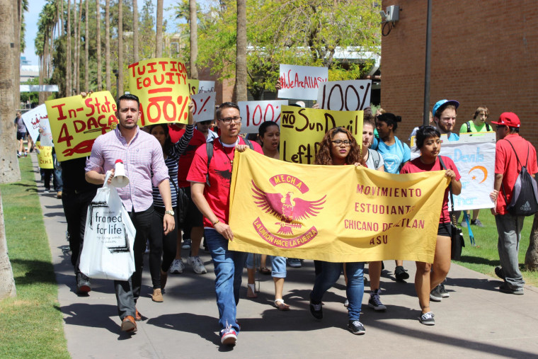 Students march down Palm Walk at the Tempe campus of ASU on April 7.  The students are calling on the Arizona Board of Regents to allow undocumented students who've been approved for deferred action from deportation (DACA) to pay in-state tuition at the state's three public universities.