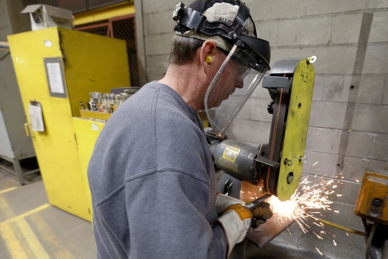 Worker in fan factory