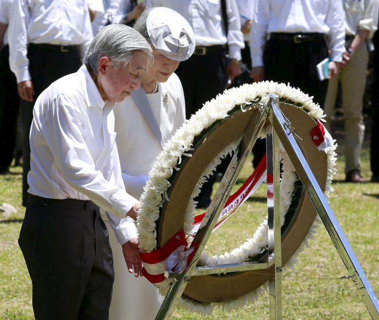 Image: Japan's Emperor Akihito and Empress Michiko lay a wreath to mourn war victims at the cenotaph for the U.S. Army's 81st Infantry Division, on Palau's Peleliu Island