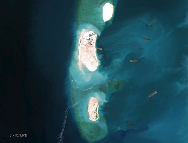 Image: Satellite image of dredgers reinforcing a site being constructed by China on the westernmost part of Mischief Reef