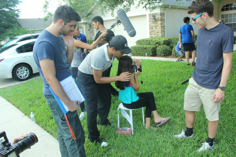 Joshua Ortiz (in cap) on the set of one of his film projects.