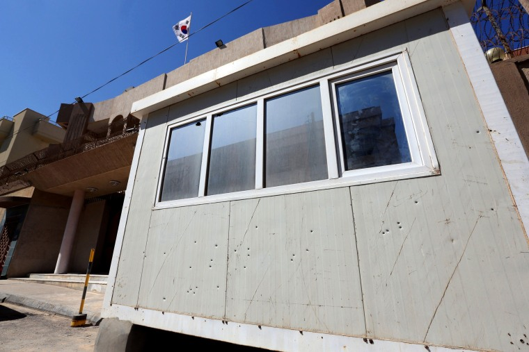 Image: Bullet holes in the guard post in front of the South Korean Embassy in the Libyan capital Tripoli