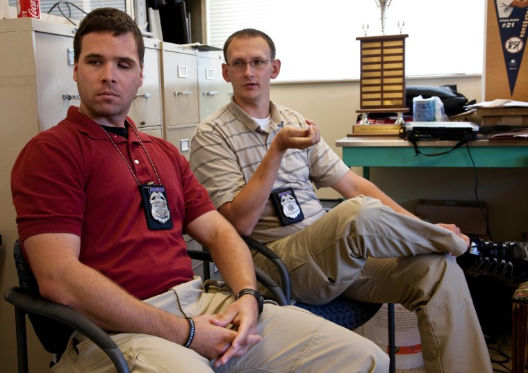 Image: Milwaukee police officer Bryan Norberg, right, and Officer Graham Kunisch