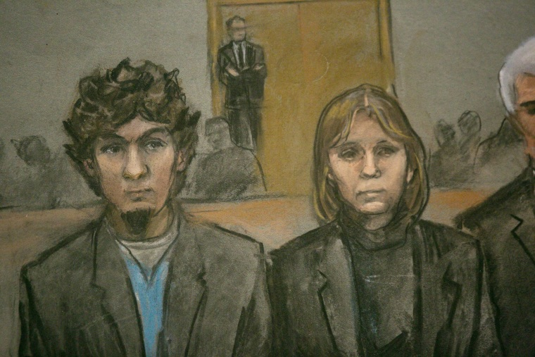 Image: A courtroom sketch shows Boston Marathon bombing suspect Dzhokhar Tsarnaev and his defense team at the federal courthouse in Boston
