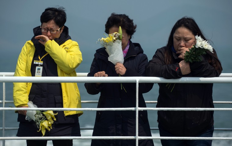 Image: Relatives of victims of the Sewol ferry disaster on Wednesday