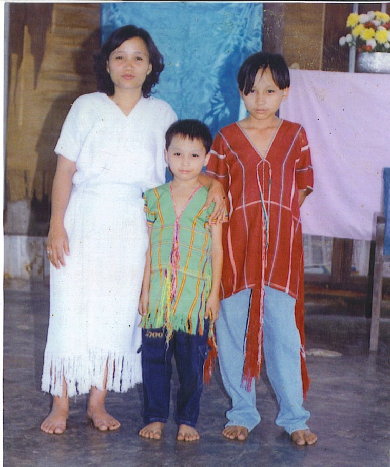 (L-R) Ta Kwe Say's mother, Ta, and his brother in Burma.