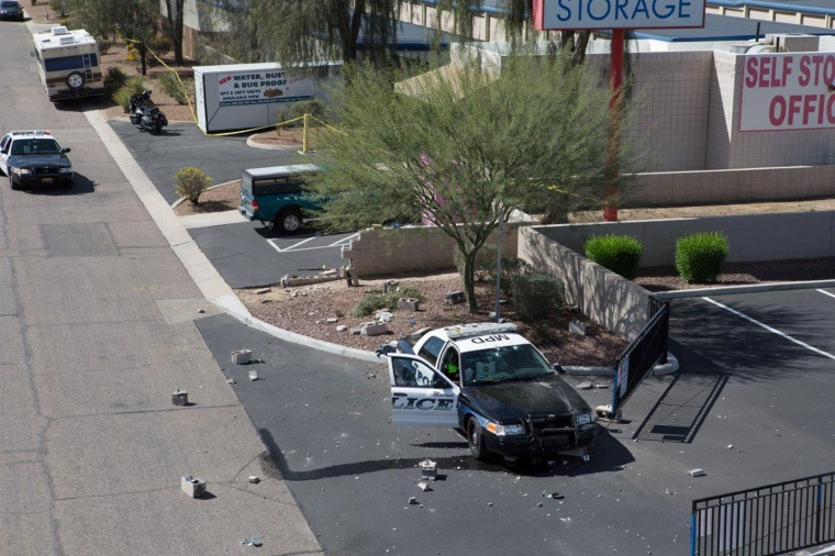 Debris is scattered after a police car plowed into an armed robbery suspect in Marana, Arizona, on Feb. 19.