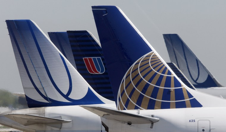 Image: A Continental Airlines plane is parked next to United Airlines planes in Chicago