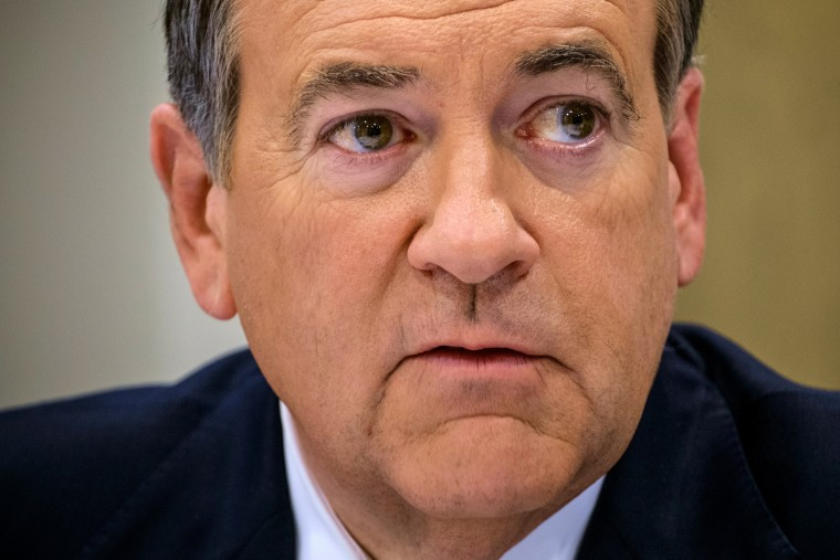 Former Arkansas Gov. Mike Huckabee speaks to reporters during a roundtable discussion in Washington, Friday April 17, 2015 about his future aspirations to run for President of the United States. (AP Photo/J. David Ake)