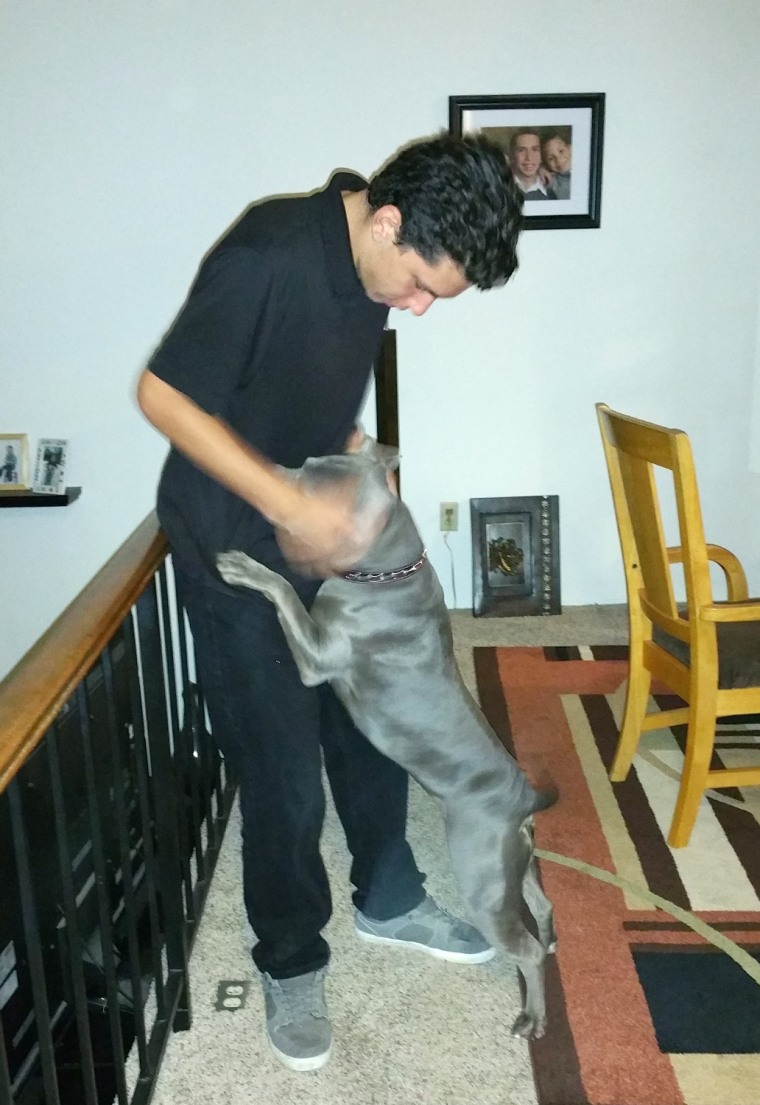 Joey plays with his dog Roxy