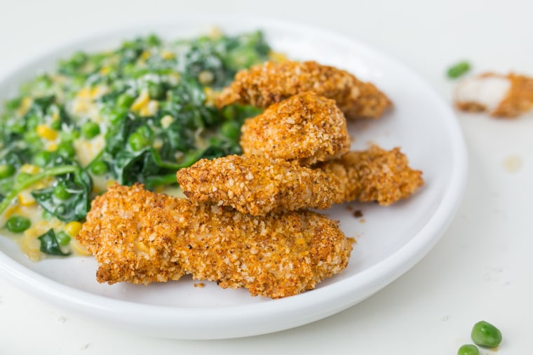 Healthy oven-fried chicken with feta, corn and spinach for a crowd-pleasing meal
