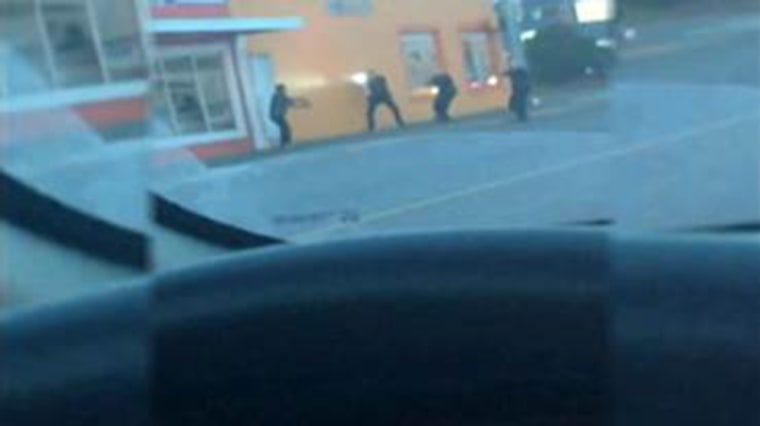 Raw cell phone video shows police officers in Washington State fatally shooting a man who was reportedly throwing rocks at them.