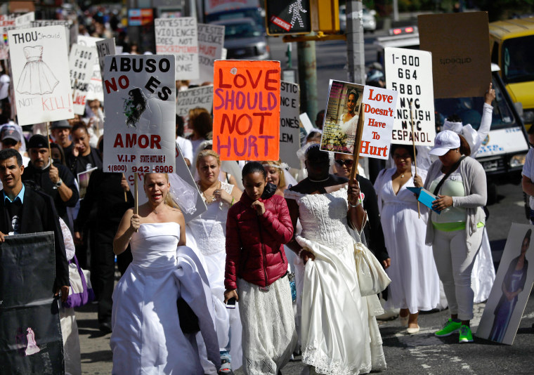Women in bridal gowns protest against domestic violence in New York