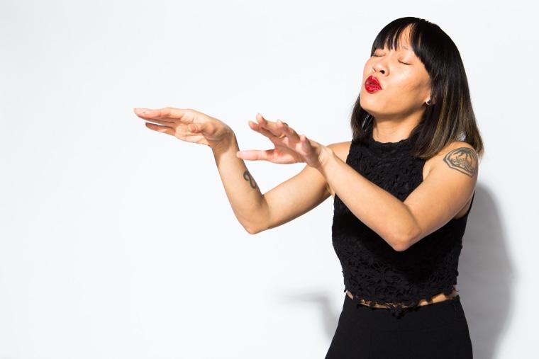 Kelly Tsai performs.