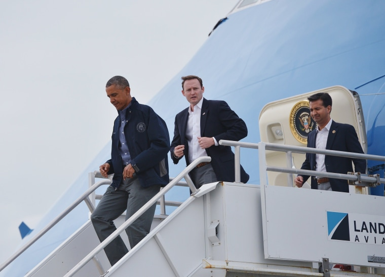 Image: President Barack Obama steps off Air Force One upon arrival at Miami International Airport