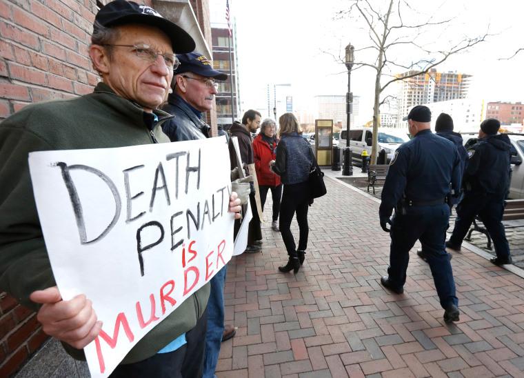 Image: Joe Kebartas protests death penalty.