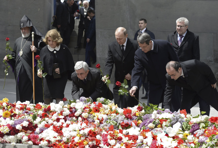 Image: Officials lay flowers during a commemoration ceremony marking the centenary of the mass killing of Armenians by Ottoman Turks in Yerevan