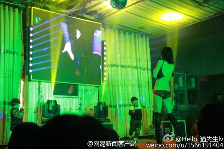 Image-Stripper performs in a funeral in China