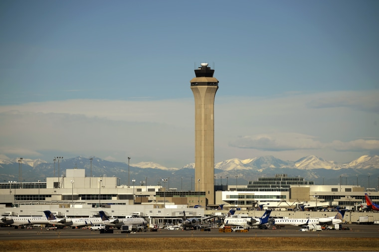 The FAA Control Tower at Denver International Airport from the far side of the airfield on February 19, 2015.