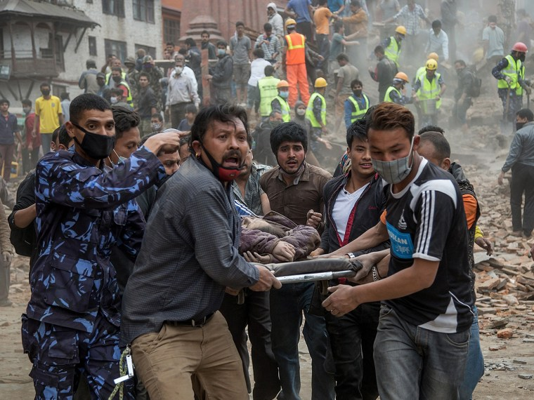 Emergency rescue workers carry a victim on a stretcher after Dharara tower collapsed on April 25,  in Kathmandu, Nepal.  Hundreds have died as tremors hit Nepal after an earthquake measuring 7.9 on the Richter scale caused buildings to collapse and avalanches to be triggered in the Himalayas.