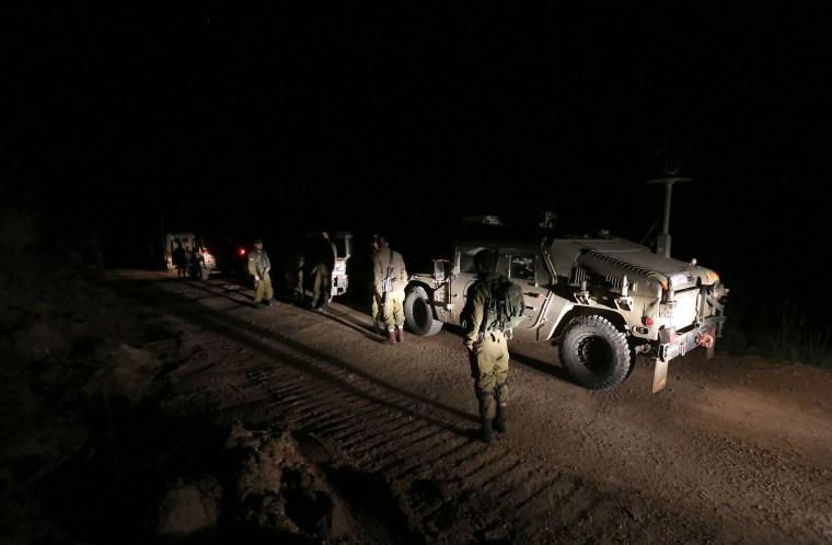 IMAGE: Israeli soldiers patrol on the Israeli-Syrian border near Majdal Shams