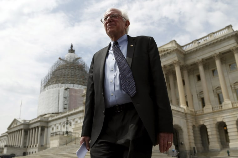 Image: Sanders walks to a news conference outside the U.S. Capitol in Washington