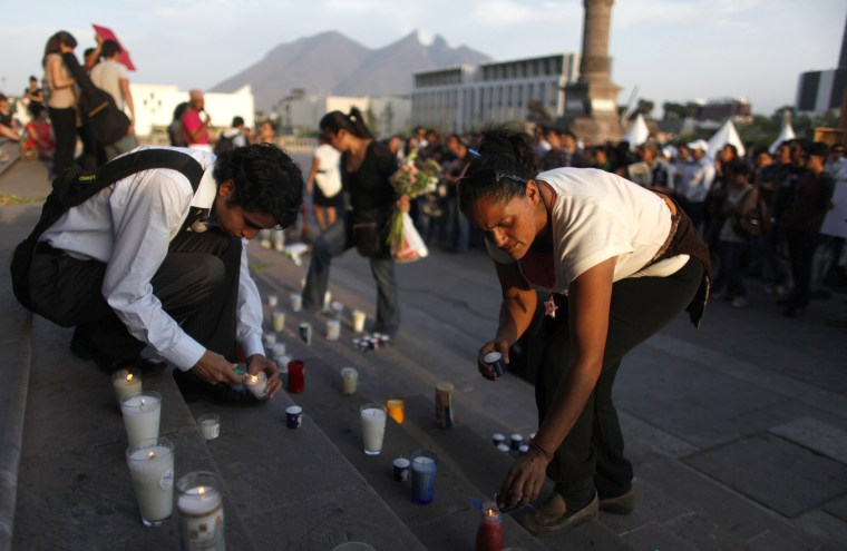 Image: Residents light up candles during a protest in Monterrey, Mexico.
