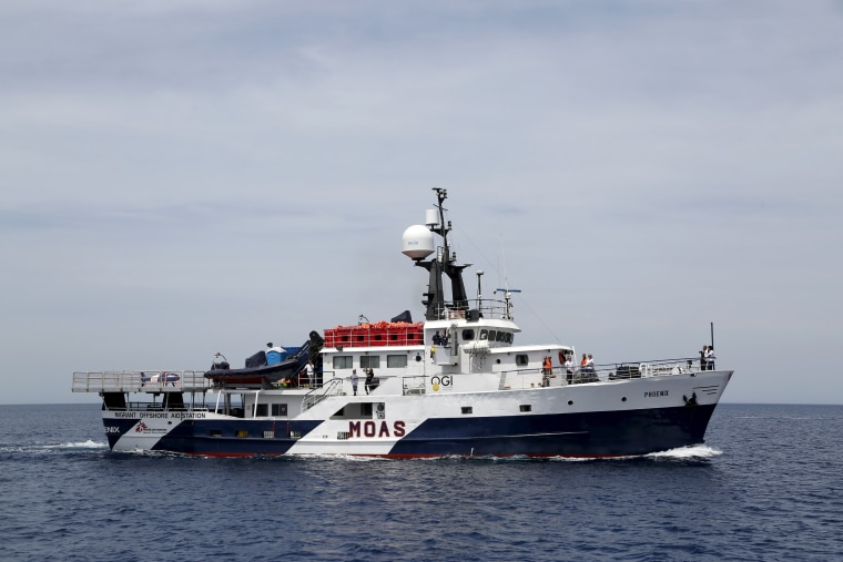 Image: The Migrant Offshore Aid Station ship MV Phoenix sails out of Valletta's Grand Harbour