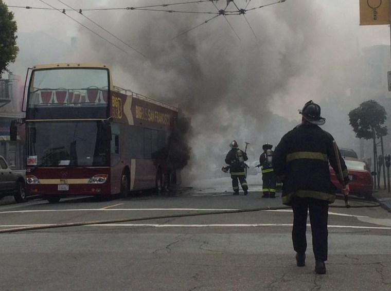 A tour bus carrying 35 to 40 people erupted into flames Sunday on Haight Street in San Francisco.